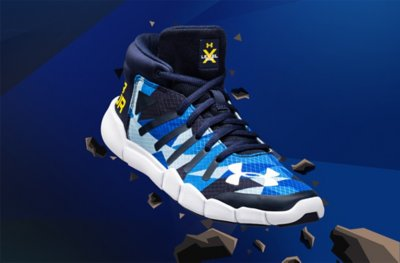 A blue & white UA X Level Destroyer Running Shoe busting through animated rocks