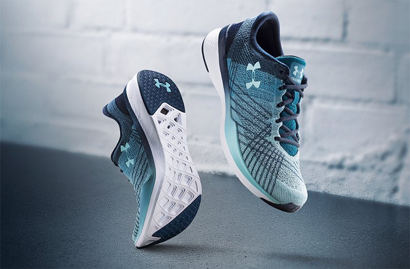 Product shot of a pair of blue UA Threadborne Push Training Shoes showing flexibility & support