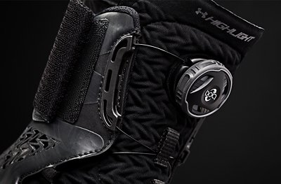 Close up on the ankle cuff with BOA closure system on an all black UA Highlight Football Cleat