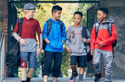 Boys wearing Under Armour Hoodies