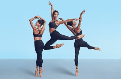 Misty Copeland wearing a black Eclipse sports bra and black leggings dancing and practicing ballerin