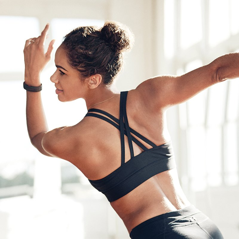 Misty Copeland wearing a black UA Armour Low sports bra dancing.