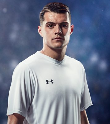 Granit Xhaka wearing a while UA soccer shirt