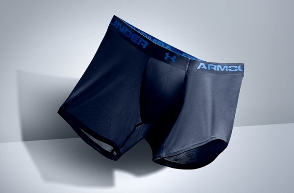 A navy blue pair of UA ArmourVent Boxerjocks seemingly floating through the air light as a feather
