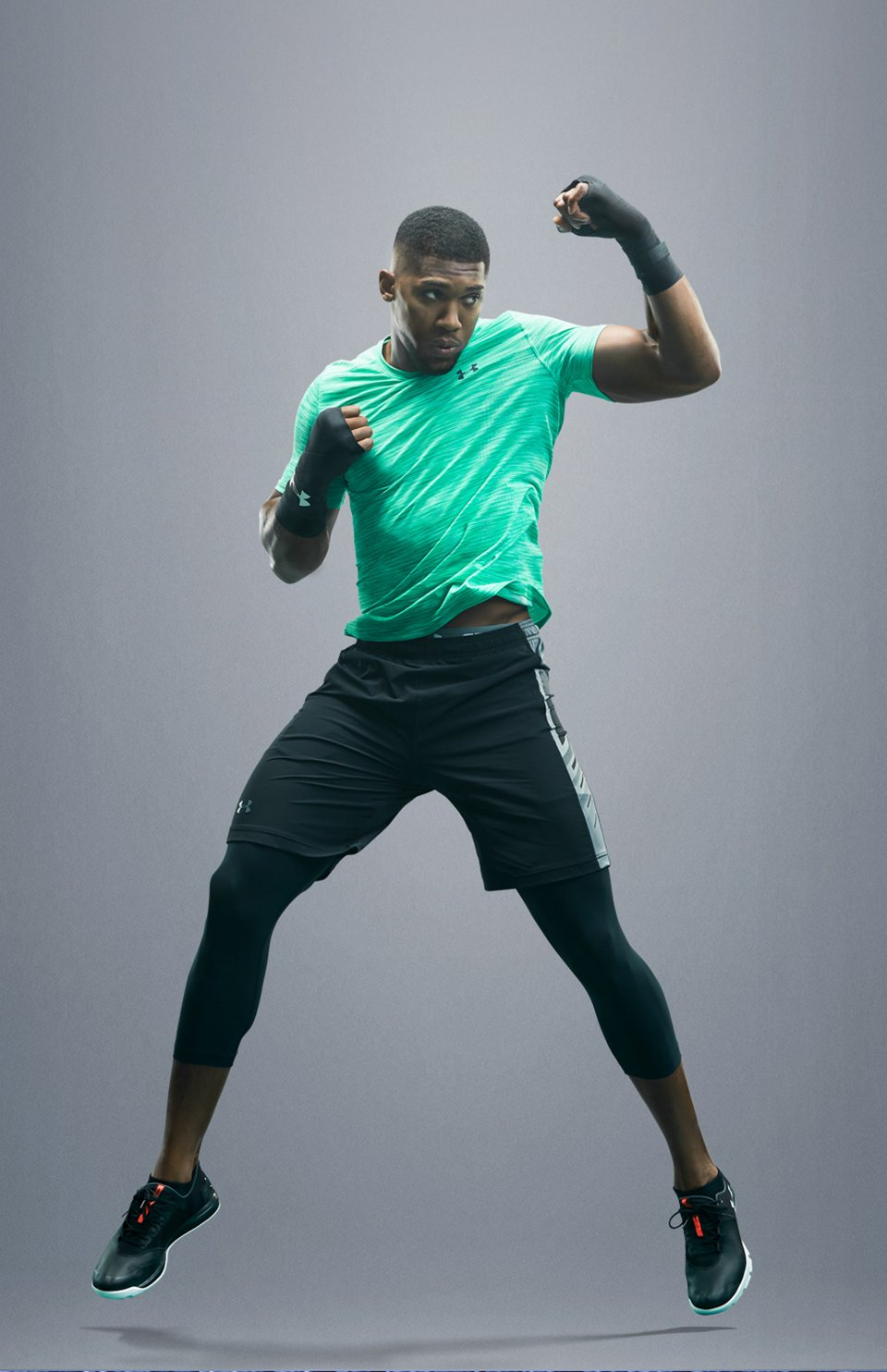 Heavyweight Champion Anthony Joshua is doing boxing training in a green Threadborne Seamless T-shirt