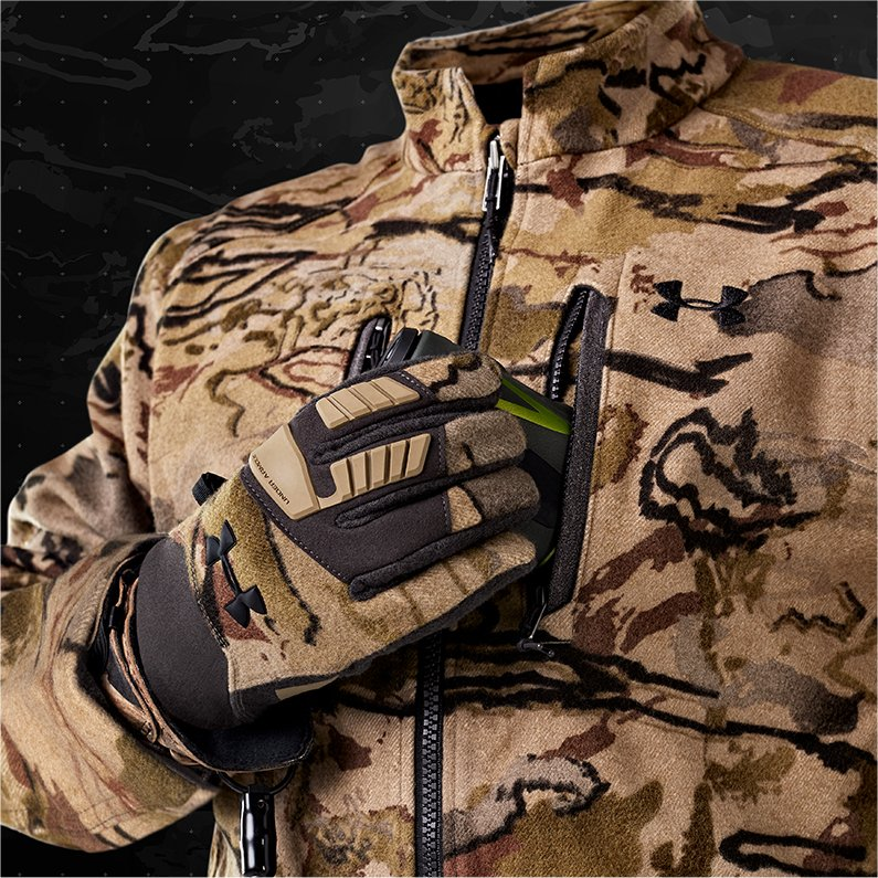 39416cb4bbe768 Invisible figure in a UA Ridge Reaper camo hunting jacket and gloves using  the front chest