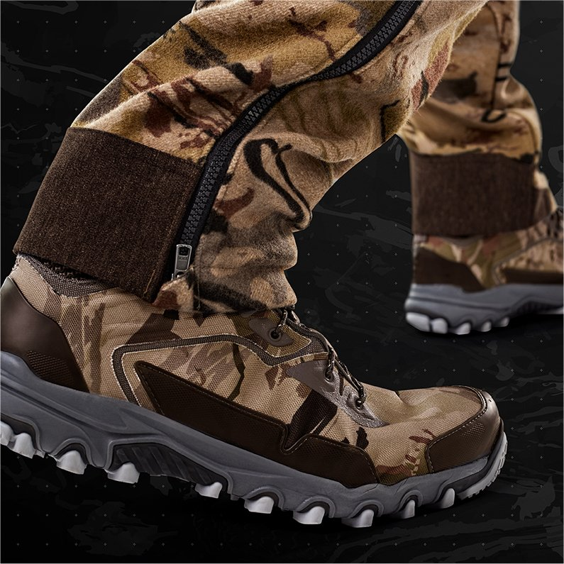 d1ef91d3104387 Close up product shot of UA Ride Reaper camo pants and hunting boots  showing the bottom