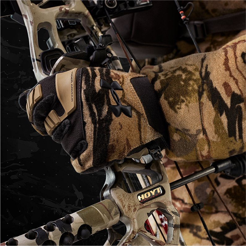 7e33e7ff141d70 Close up product shot of UA Ridge Reaper camo hunting gloves being worn  while drawing a