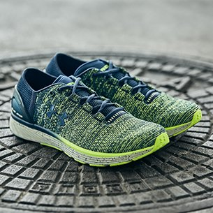 new product 50f3a 89a6d Close up shot of pair of blue and green UA Bandit 3 Running Shoes on a