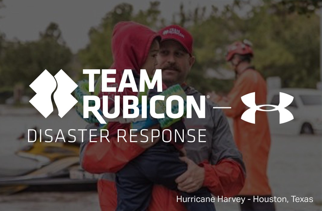 Team Rubicon disaster response & Under Armour logos with man carrying boy after Hurricane Harvey