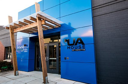 Bright blue entrance to the UA House at Fayette community center welcoming residents of all ages