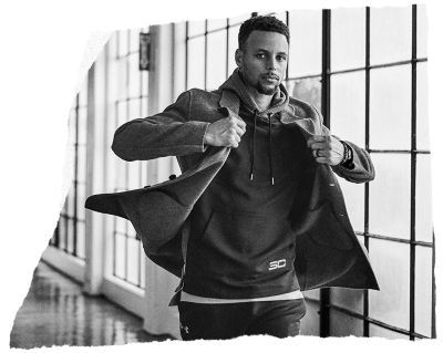 Stephen Curry walking & putting on a jacket over his black UA SC30 hoodie while off the court