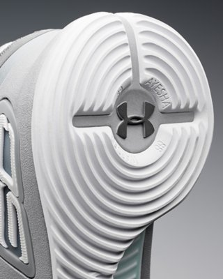 Close-up shot of the bottom sole of the UA Curry 4 basketball shoe showing ultimate traction