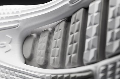 Close up shot of white UA SpeedForm® AMP 2.0 Training Shoe showing deep grooves in the sole for fle