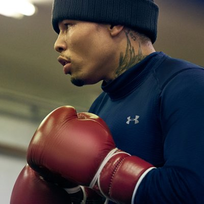 "Close-up on Gervonta ""Tank"" Davis standing ready with gloves up wearing navy UA long sleeve & beanie"