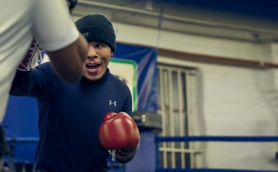 "Gervonta ""Tank"" Davis sparring in the gym wearing a navy UA mock long sleeve & beanie"