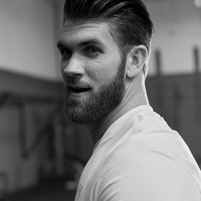 Close-up on Bryce Harper wearing white UA Threadborne Shirt in the gym