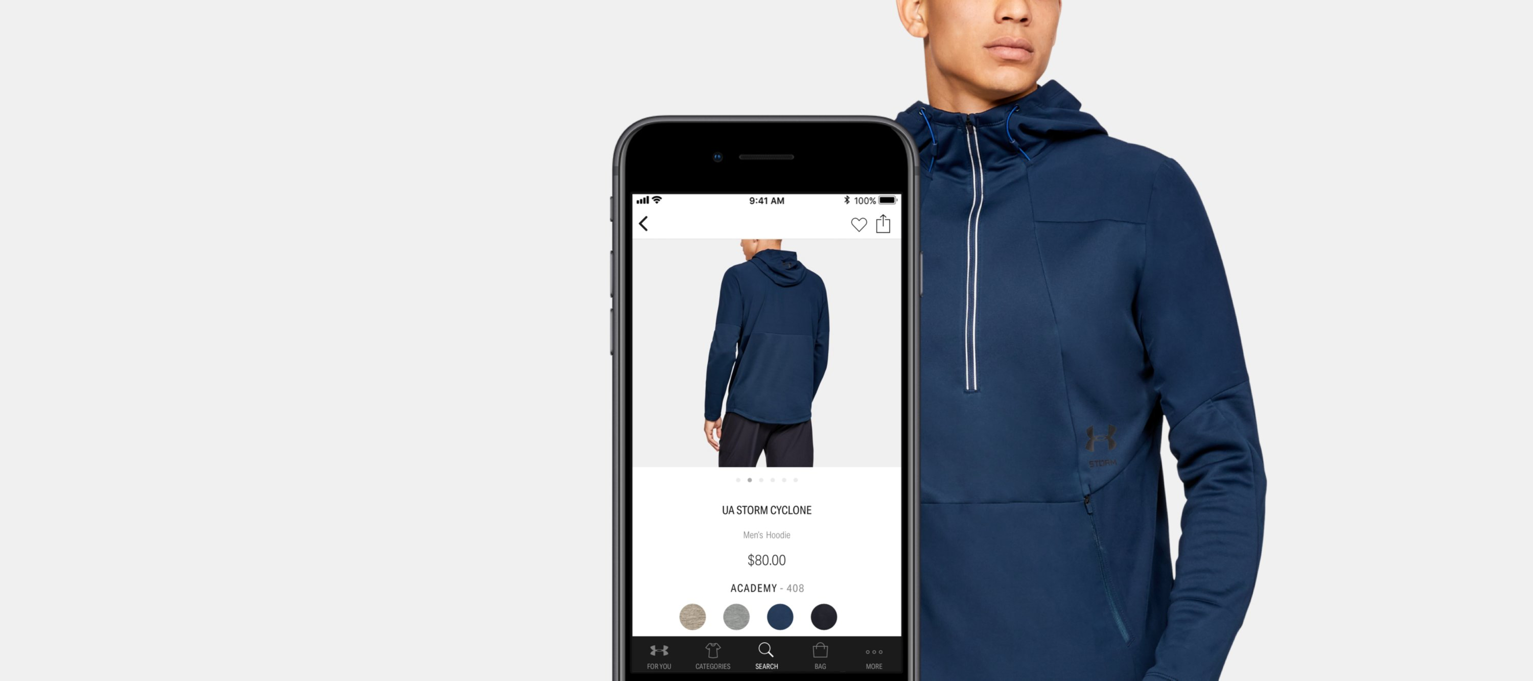 Guy wearing UA Sportstyle Woven Bomber with iPhone showing where to buy on The Under Armour App
