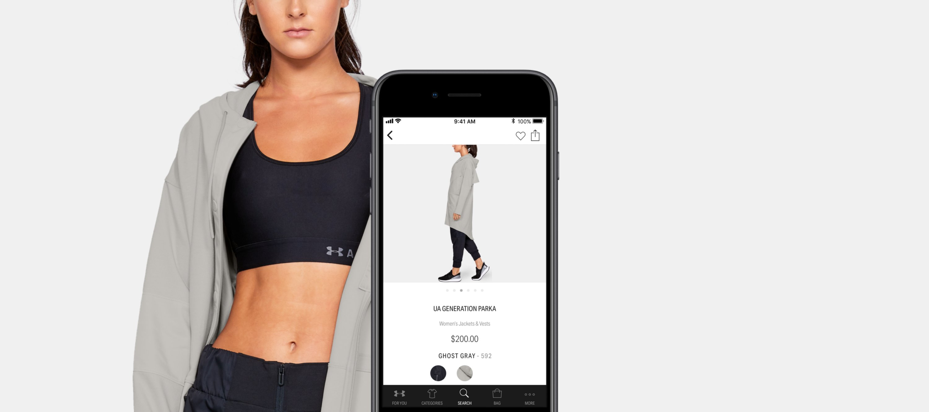 Woman wearing UA Sports Bra with iPhone in front showing where to buy the bra on The Under Armour Ap