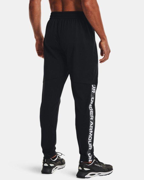 Men's UA Tricot Track Pants, Black, pdpMainDesktop image number 2