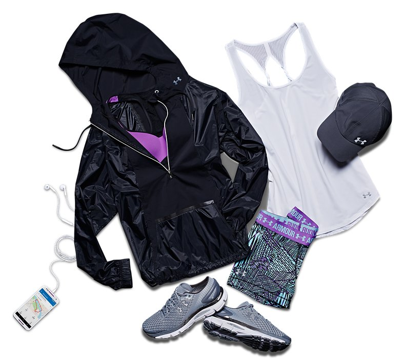 Women's UA running jacket, tank, shorts and shoes from ArmourBox next to a cell phone and headphones