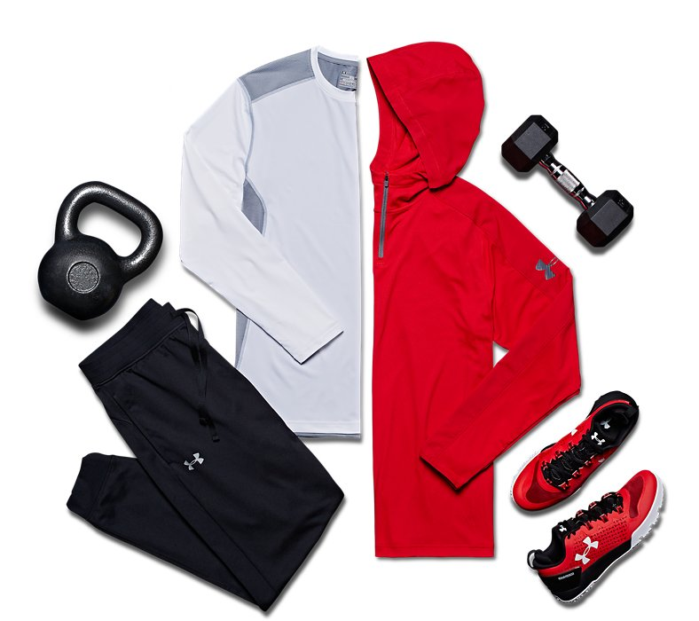 Men's UA training shirt, hoodie, joggers and shoes from ArmourBox, laid out beside weights